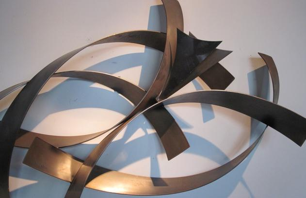 there is also how big the empty space to think about whether one is a minimal who does choose one over the top piece as a focal point or a collector that - Metal Wall Sculpture