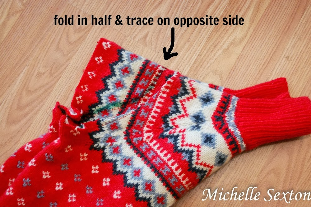 fold the sweater in half to trace the arm cutouts - upcycle a sweater