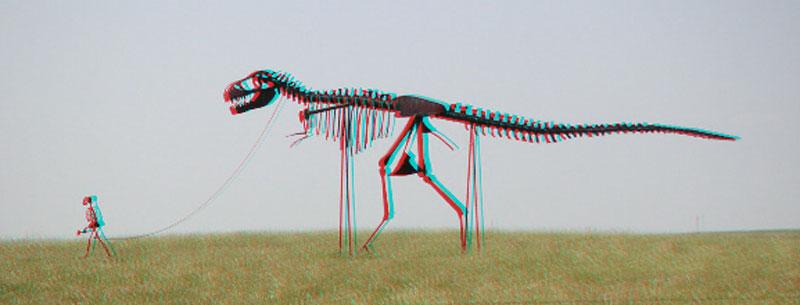 3D photo of man walking a dinosaur skeleton sculpture