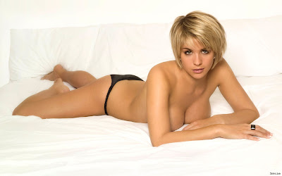 naked girl laying on bed photo