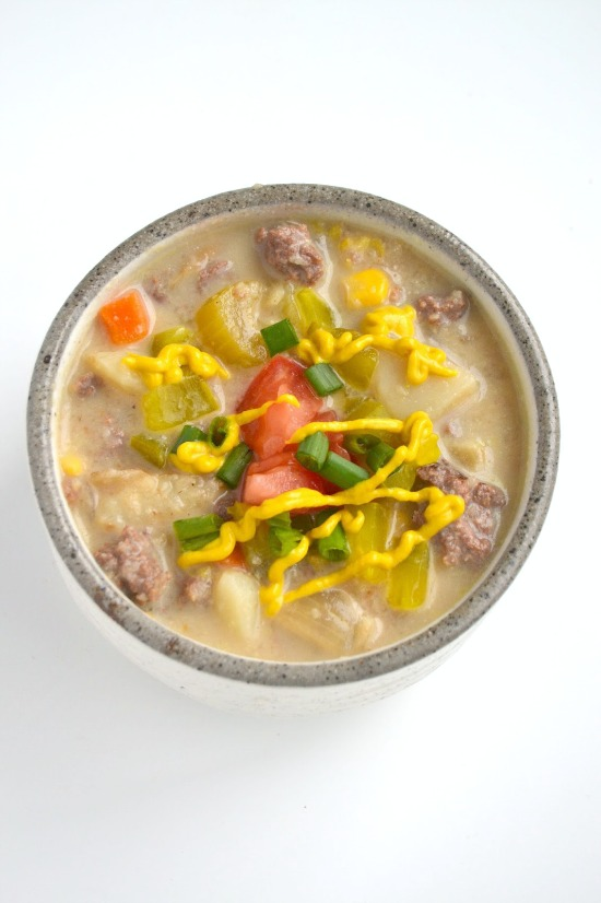 This cheeseburger soup tastes just like your favorite burger! It is a lightened up version yet tastes rich and creamy! www.nutritionistreviews.com