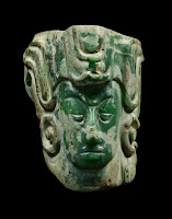 Face of the Young Maize God showing the preserved texture of the jade stone it was crafted from