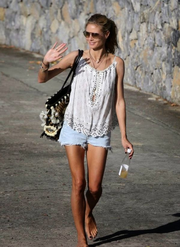 Heidi Klum wore a daisy duke to showing her still long legs as she enjoyed the other moment at the beach on Saturday, December 27, 2014.