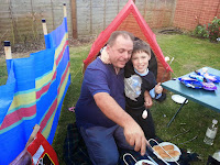 Father and Son Outside Tent