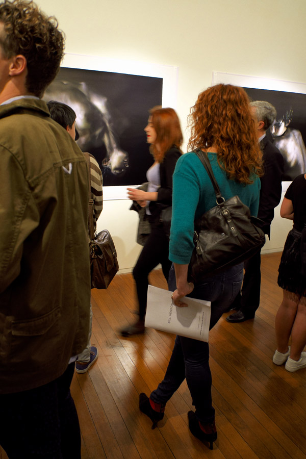 Admiring the art, the work at the opening of Bill Henson '2012' Roslyn Oxley 9 gallery.