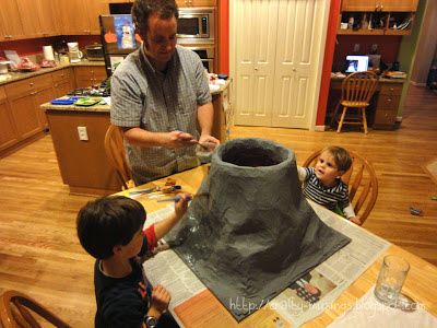 boys painting the volcano
