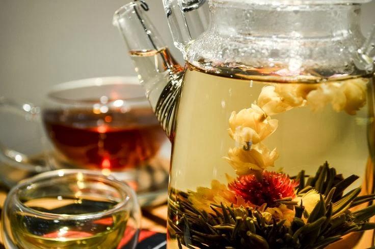 Herbal tea in jug and cups