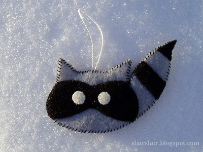 Felt raccoon ornament from pattern