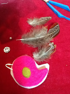 preparing to bezel bead the felted bird cabochon