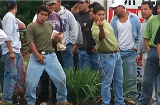 illegal aliens, illegal immigration, flipping the bird, the finger, grabbing crotch