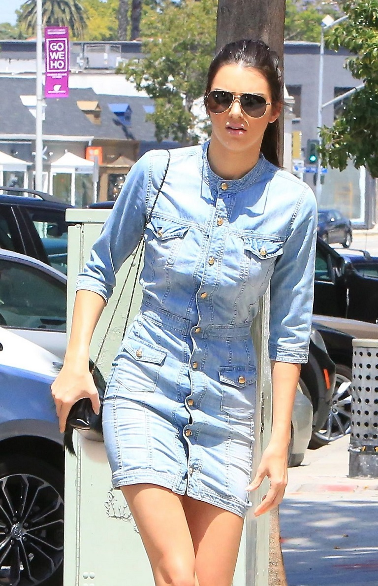 Kendall Jenner out and about in a denim mini dress in LA