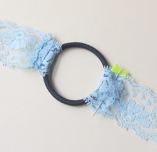image attaching lace ribbon to a hair elastic to make a headband