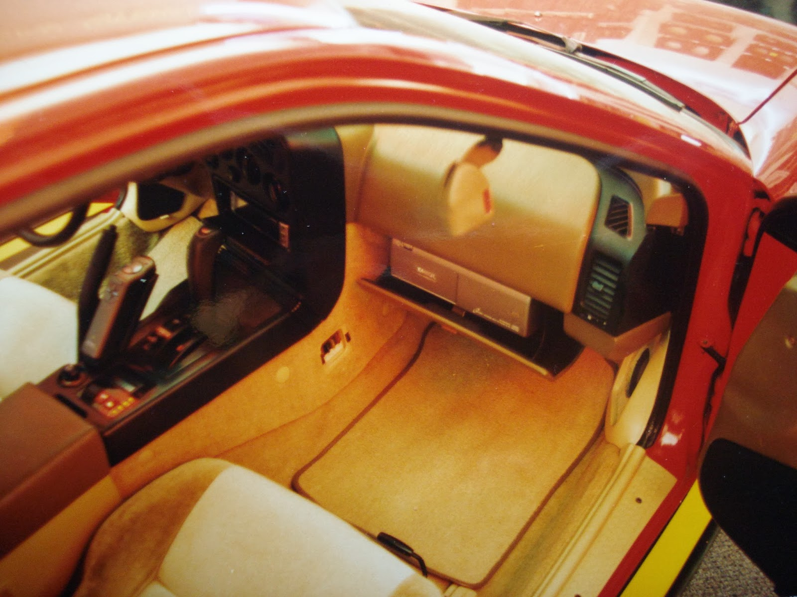Photo image of the front interior showing the motorized CD changer and head unit in Chuck Barbosa's Red Laser as it stood during the winter storage at the end of 1995 and beginning of 1996.