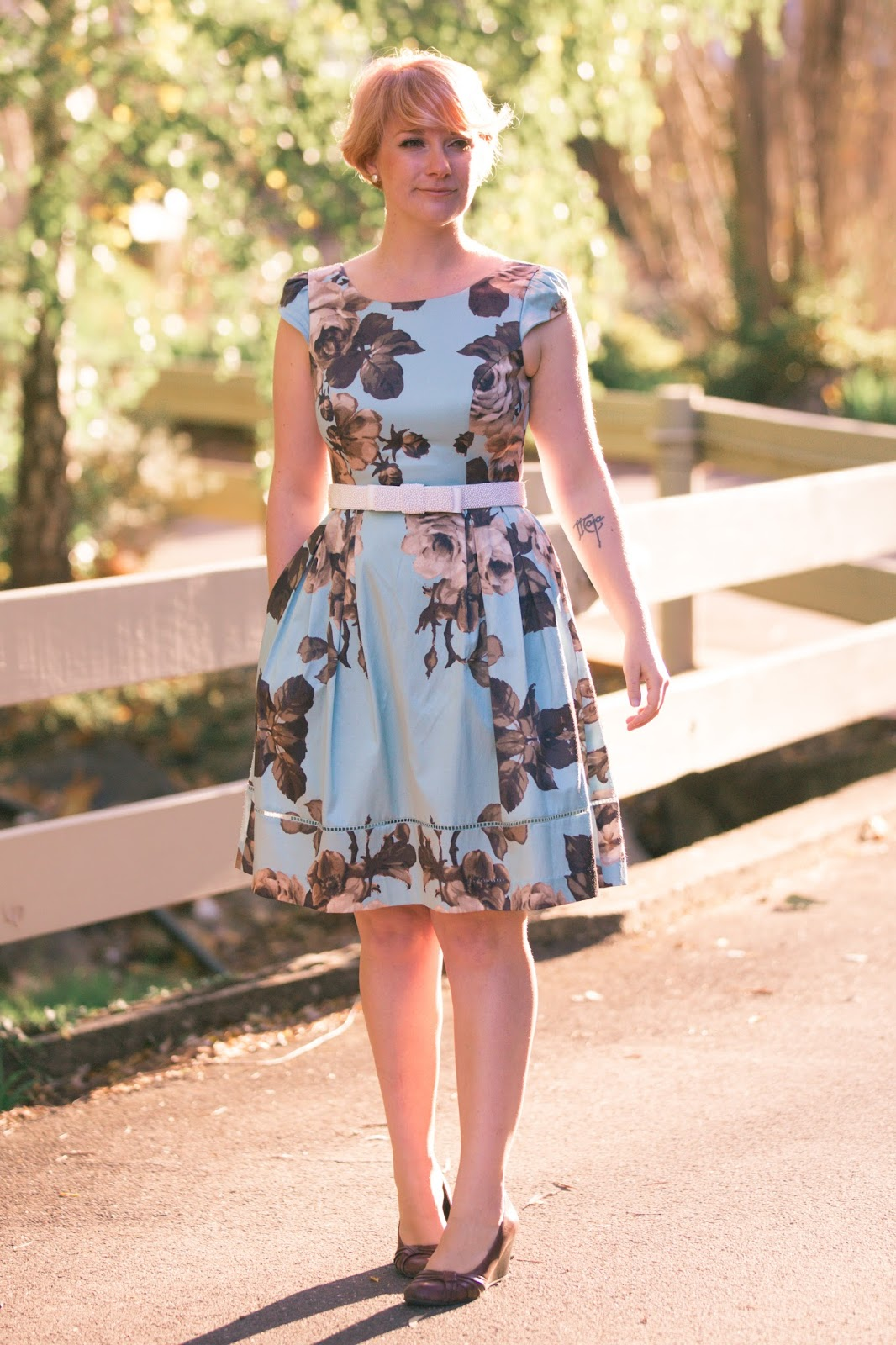 Finding Femme wears Review Australia blue floral dress and pearl belt.