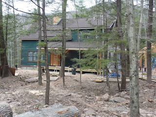 timber frame home under construction in the catskills