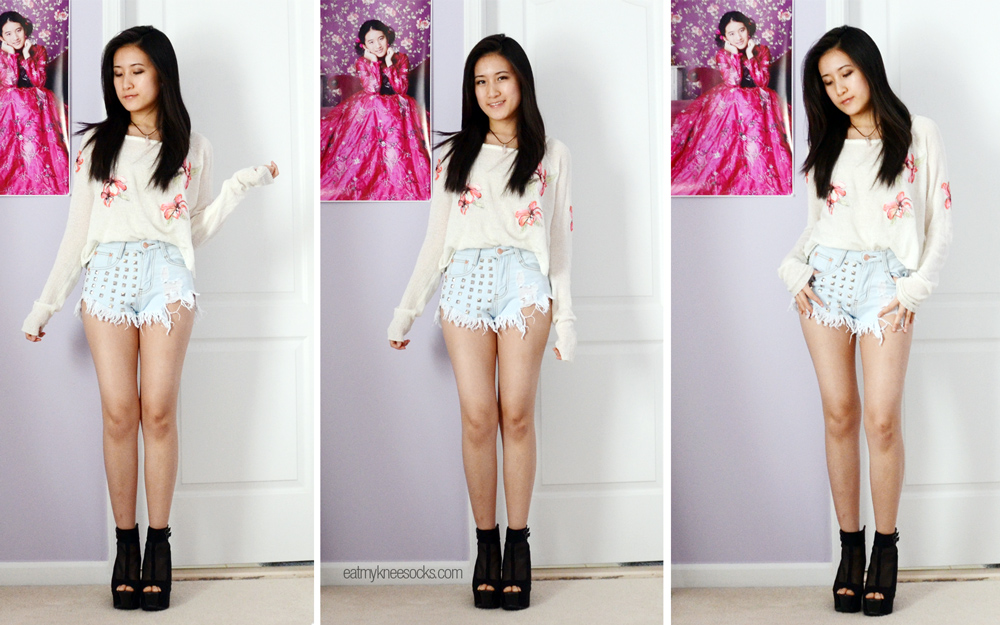 Full-body outfit including JollyChic high-waisted studded shorts, JollyChic crystal choker, and Snidel-inspired floral knit top.
