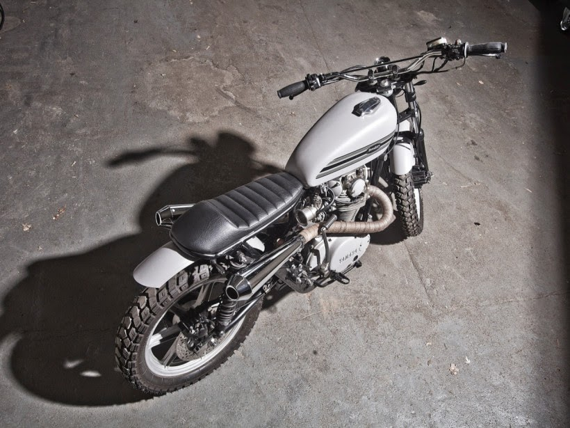 "Yamaha XS650 Scrambler | Yamaha Scrambler. custom Yamaha XS650 Scrambler by Benders based on a 1981 Yamaha XS650 3L1. this custom Yamaha XS650 Scrambler features a Custom handle bars, Custom gas tank, Custom Scrambler fenders, Custom scrambler Exhaust, Keihin Carburetor, Kellermann blinkers, Heidenau Tires, Yamaha XS650 Scrambler seat. This Yamaha XS650 Scrambler is named ""Grauer Star""."