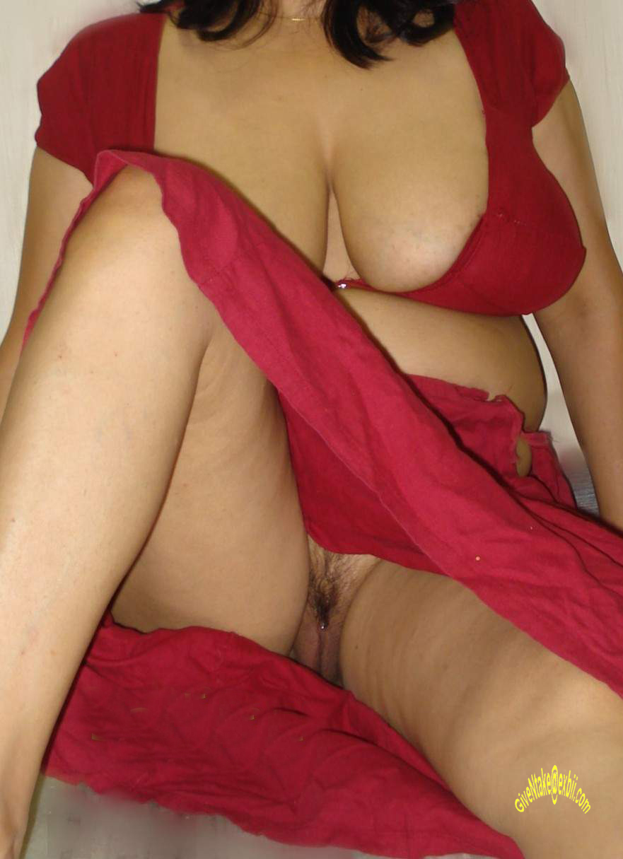 in Desi bhabhi red saree semi nude