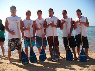 Kealakehe with their new Lanikai Blue Tattoo hybrid outrigger paddles