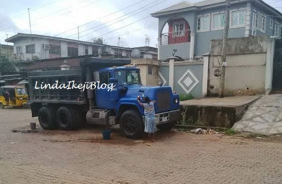Photos: Child labour - Young girl made to wash truck everyday