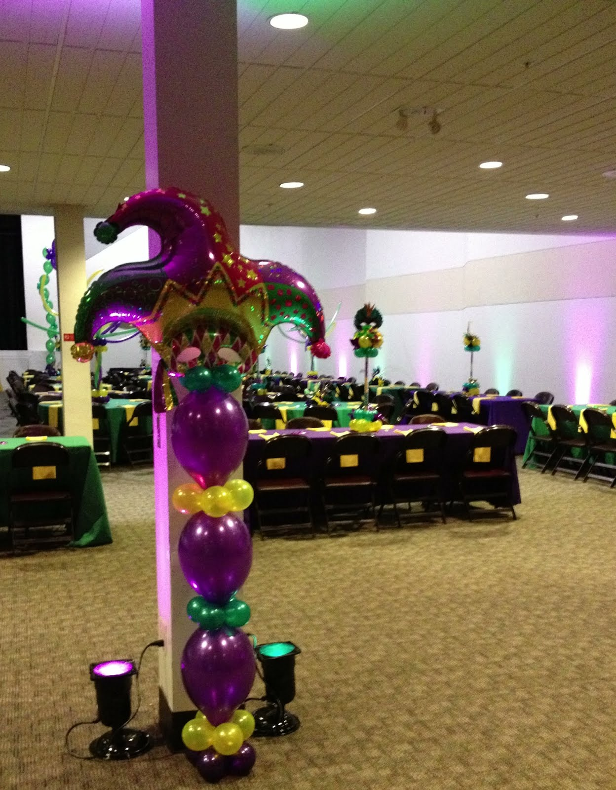 Party people event decorating company mardi gras awards banquet 2012 as employees walked into the room green and purple uplights gave a nice glow mardi gras foil topper on linking balloons bring color to the space amipublicfo Images