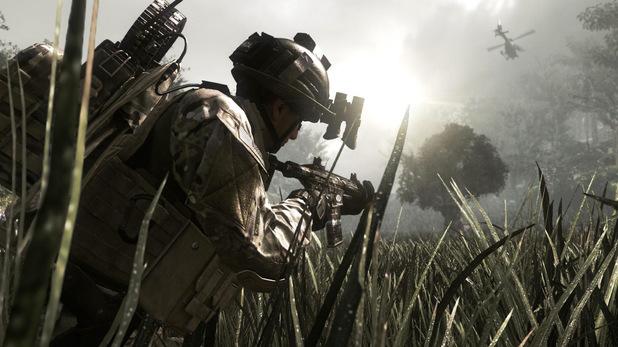 Screenshot of Call of Duty: Ghosts with soldier in tall grass and helicopter in the distance
