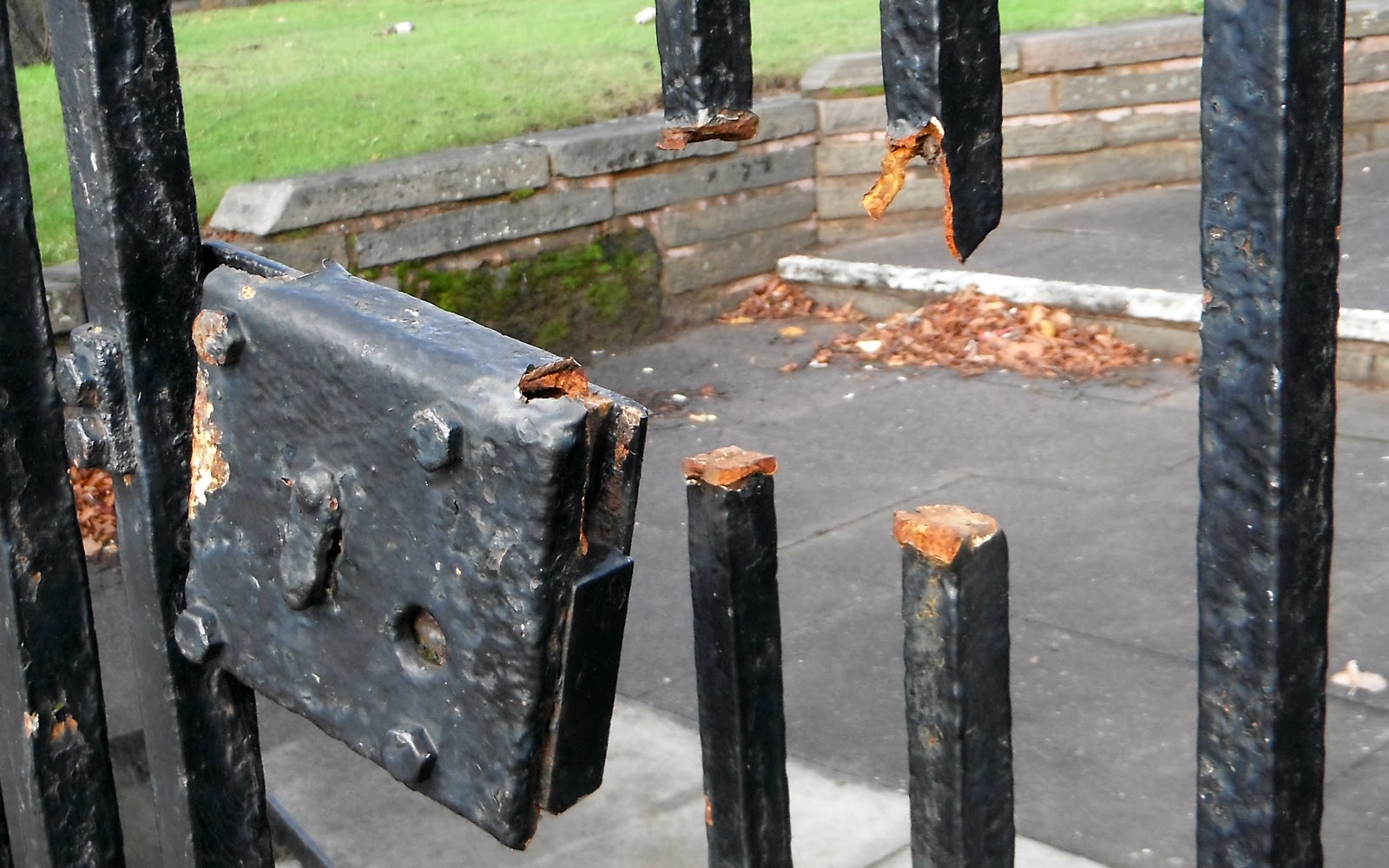 Broken lock on gates to the churchyard in Cannock