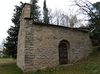 La façana de migdia amb el nou portal de l'ermita de Sant Quirze de Subiradells