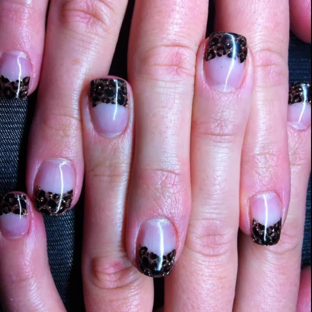 gold french glitz tips with hand painted black leopard print acrylic nail art design