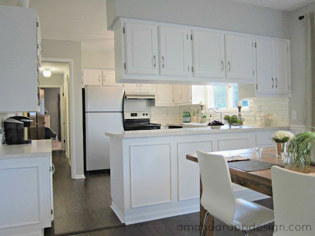 painted white cabinets, picture frame molding, farmhouse table, modern chairs. Visit amandarappdesign.com for the Before & After!