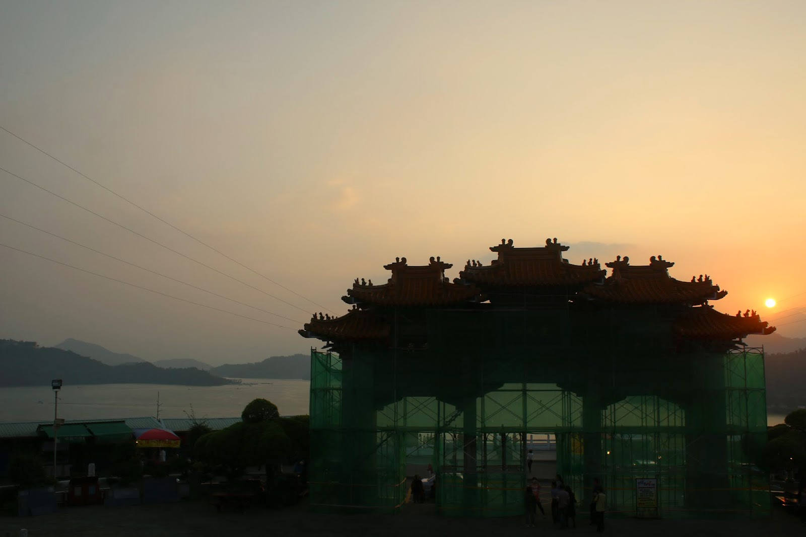 Beautiful sunset overseeing the northern shore or Sun Moon Lake and the main gate entrance of Wenwu Temple in Puli County of Taiwan