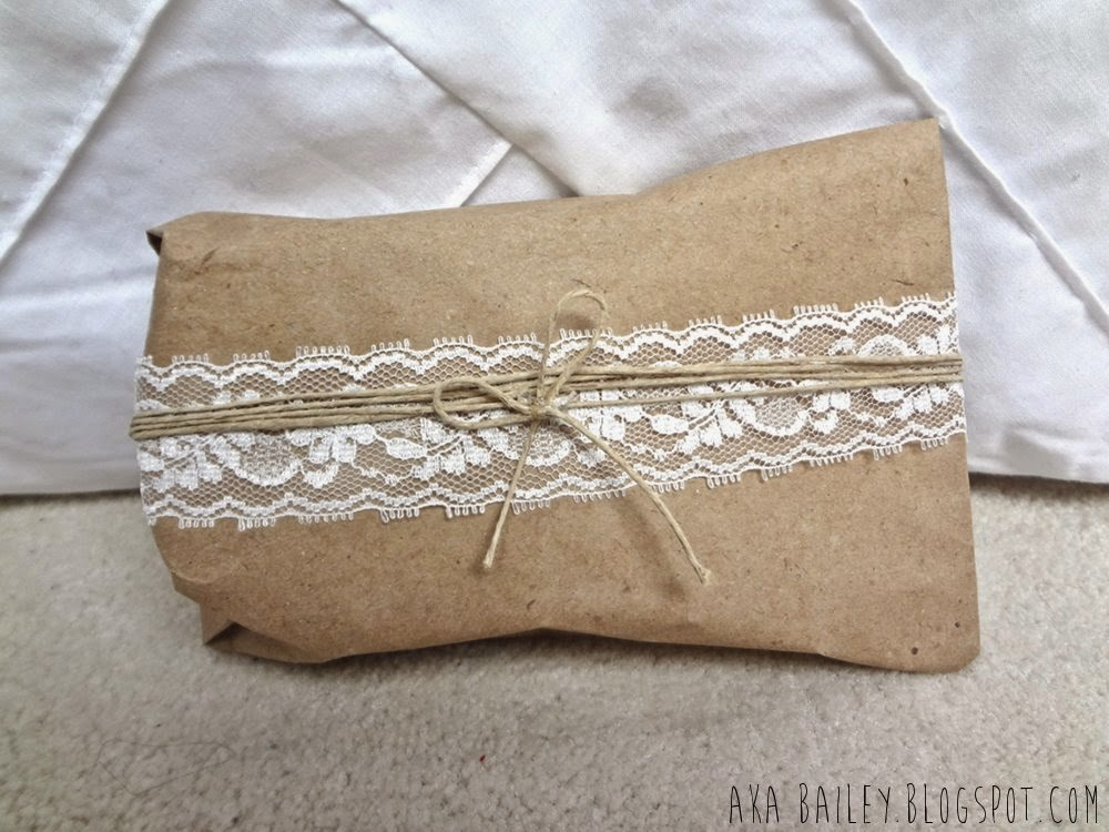 Brown paper gift wrap wrapped with lace and hemp twine
