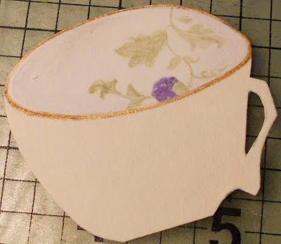 handmade paper cup in progress, the inside part has a botanical motif with a purple berry
