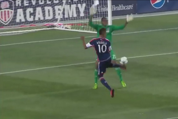 New England Revolution player Juan Agudelo flicks the ball to score against Chicago Fire