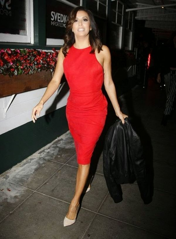Eva Longoria wears a red dress at the Svedka Vodka's Stupic Cupid party in West Hollywood on Wednesday, February 4, 2015