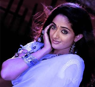 Kavya Madhavan in blue dress