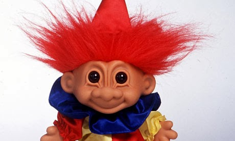 troll doll smiling at you with dead eyes