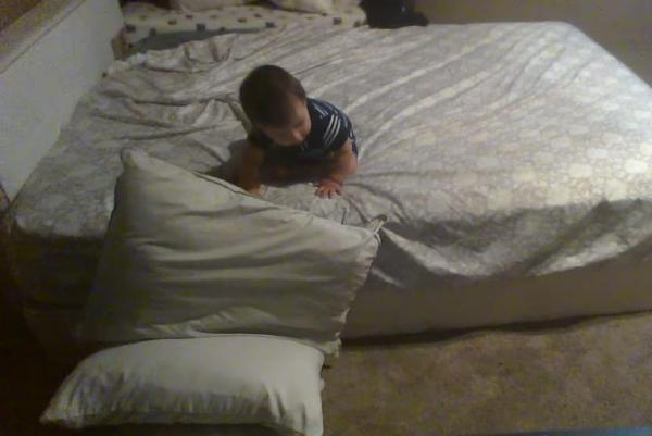 An incredibly smart baby has become a global sensation by throwing its pillows down to create a cushion to get off its bed.  A video of the incident shared by the  California baby's father, Francisco Aguilar, has gone viral.  Francisco Aguilar installed a CCTV to catch his son, whom he calls a genius, red handed.