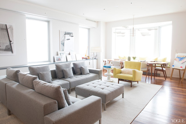 white gray color palette interior design grey sectional sofa yellow side chair modern new york city apartment house vogue