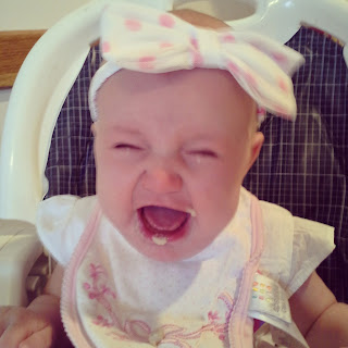 Cute Crying Baby Wearing a Big Bow