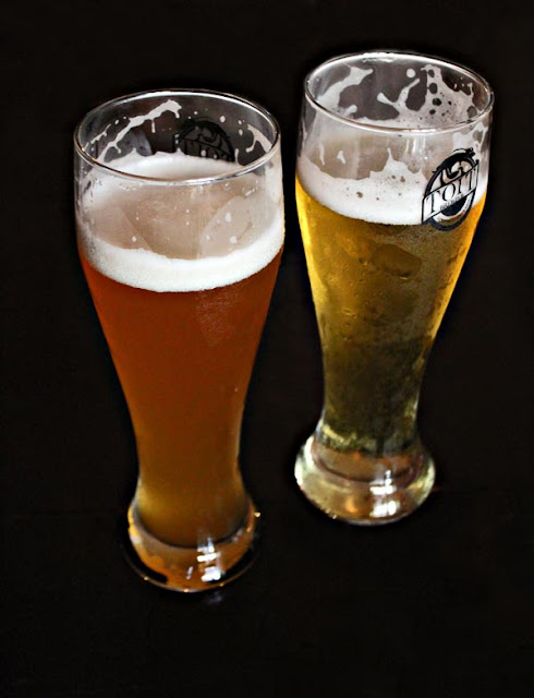 two beer glasses full of beer