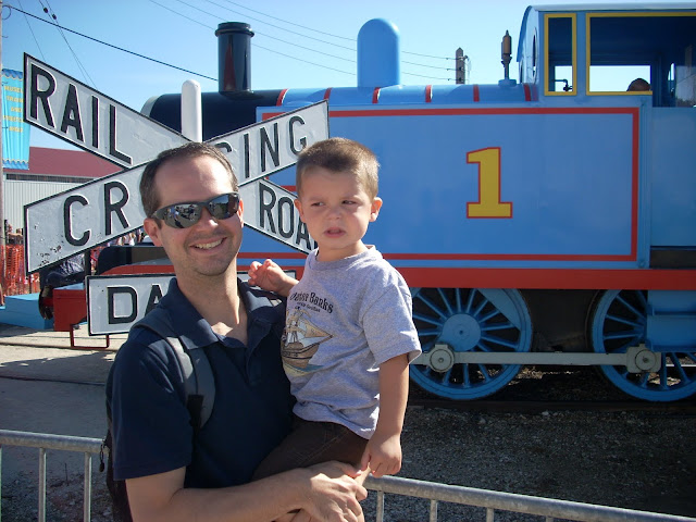 Father and son with Thomas the train