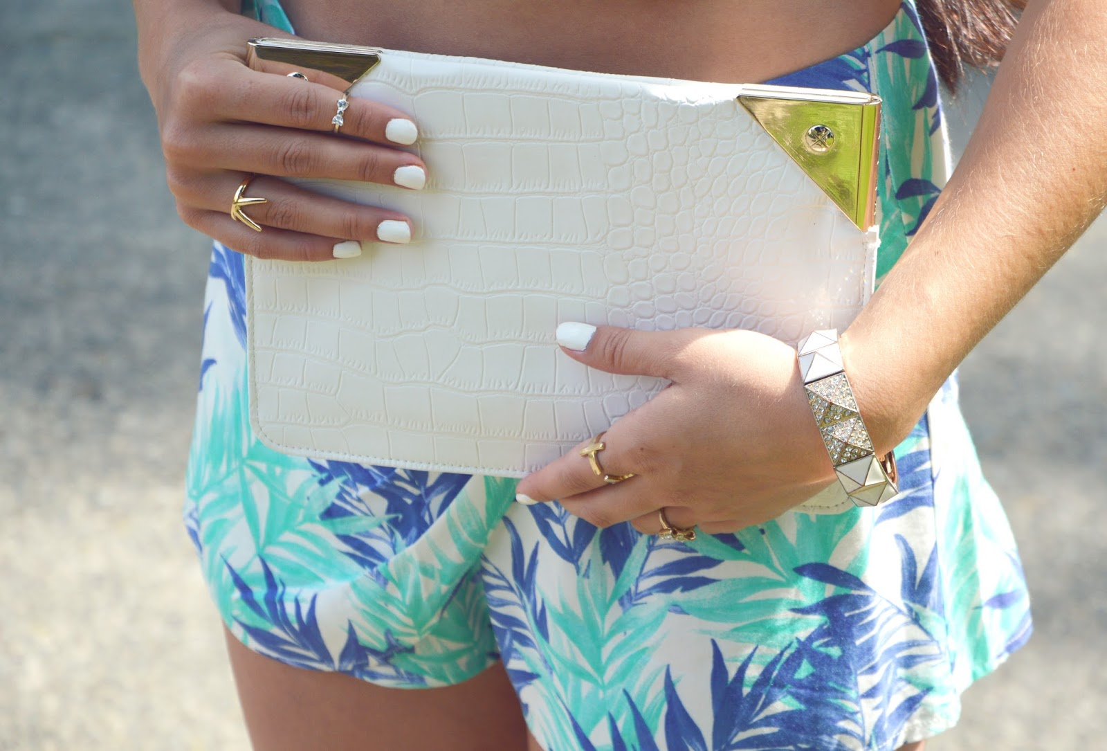 summer tropical wrap shorts and white clutch