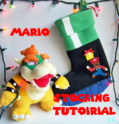 Mario themed stocking made from green fleece with Mario game detailing