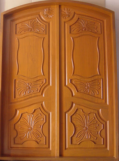 New kerala model wooden front door double door designs for Exterior wooden door designs