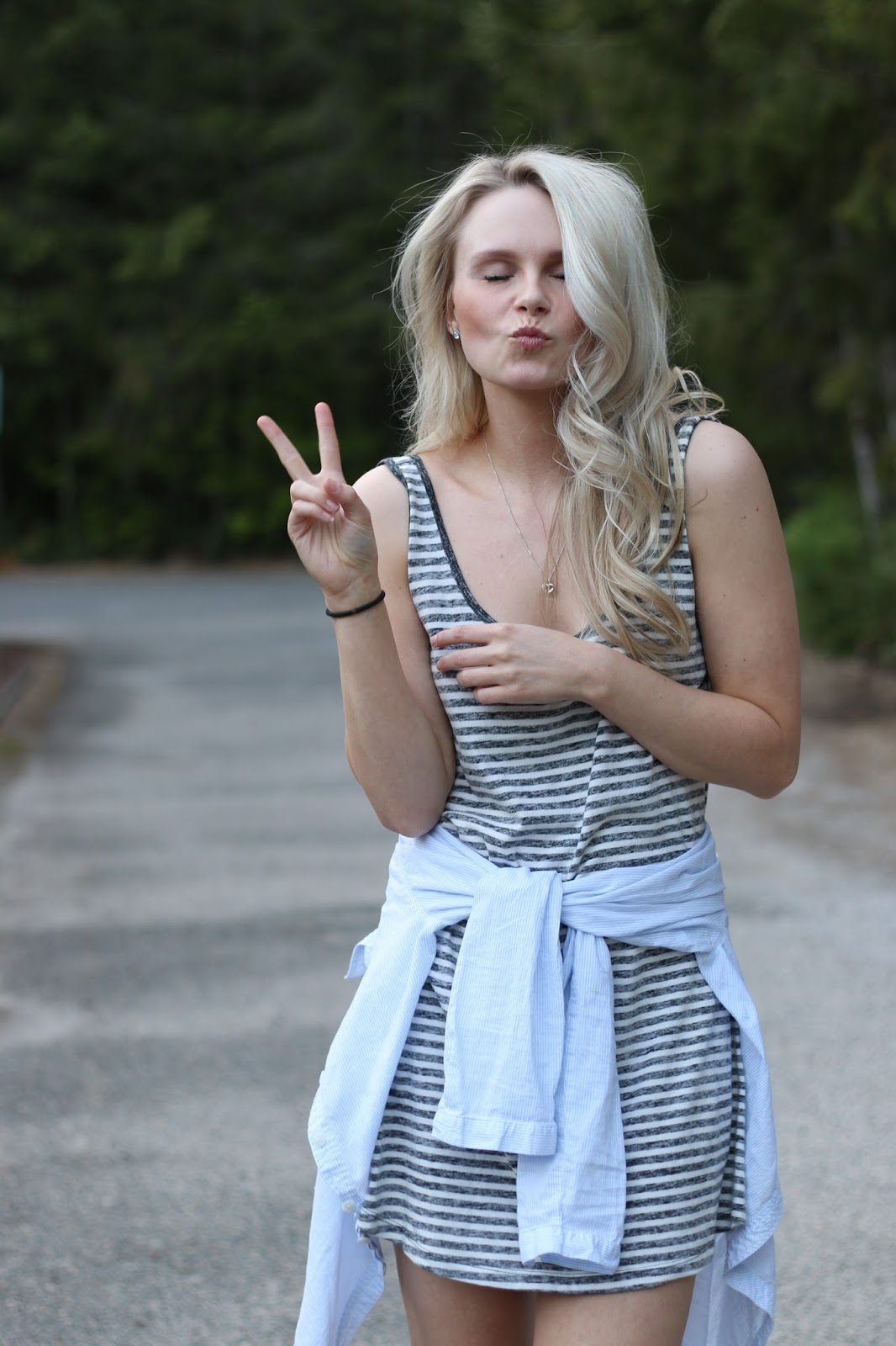 style blogger blows kisses and peace signs to camera