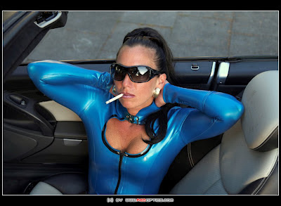 Sexy Latex Mistress Smoking Cigarette
