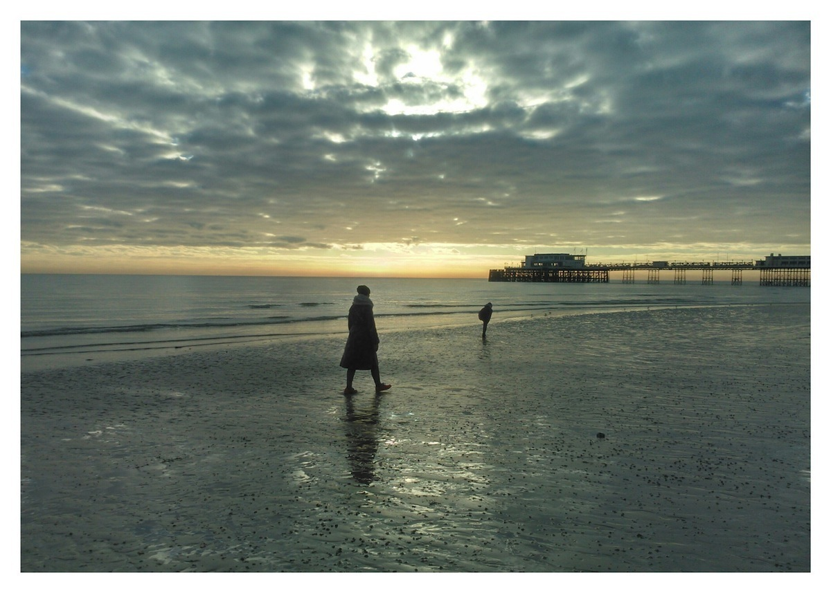 Walking on Worthing beach at low tide