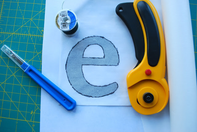 "Tracing the ""e"" onto the WonderUnder for the applique"