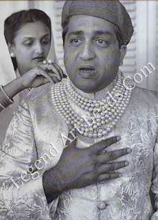 Pratapsingh Gaekwar is helped into Baroda's famous seven-stranded pearl necklace by his second wife, Sita Devi, a woman renowned for her avaricious love of jewels.